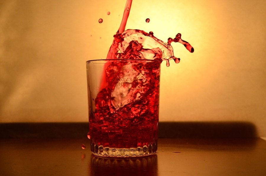 Red drink poured into glass