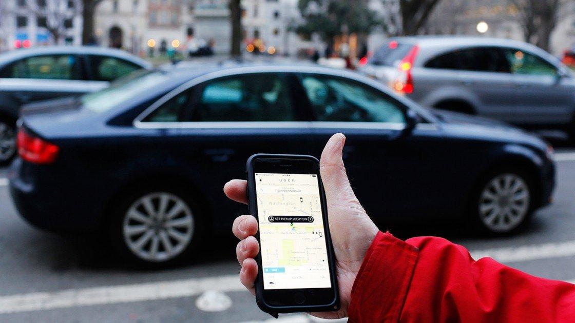 Rider hailing Uber car