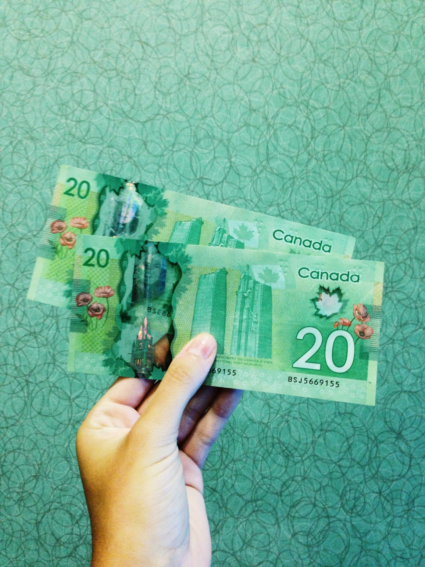 Women's hand with Canadian money