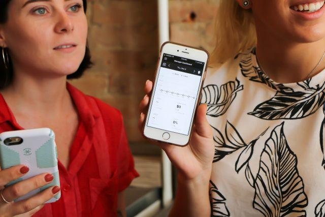 women holding mobile phone