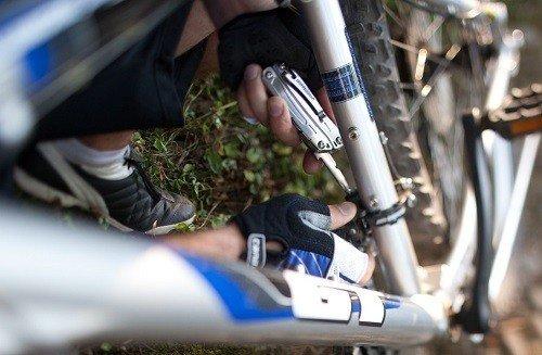 Using Multi-Tool For Bike Repair