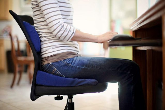Women sitting in chair on seat cushion