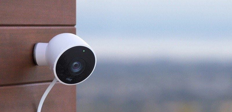 Nest Cam security camera outside on wall
