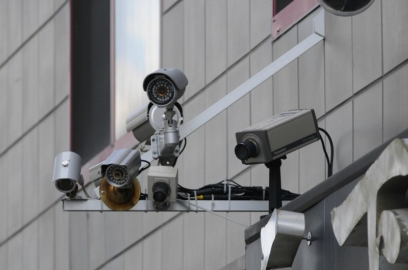 several security cameras outside a building