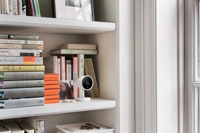 Security camera on bookshelf
