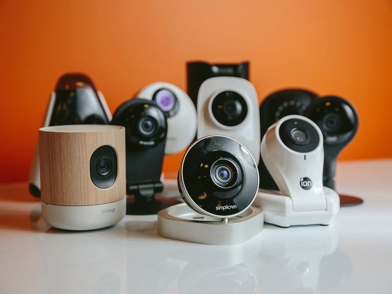 several different types of security cameras on a table